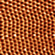 Hexagonal lattice structure of HOPG. Tunneling current image, 0.3 nA setpoint, 50 mV bias.